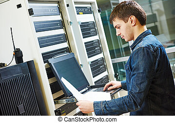 service engineer in server room - network engineer working...