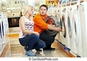 woman shopping at home appliance supermarket - Young man...