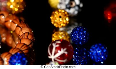 Various colors of beads isolated on black background, close...