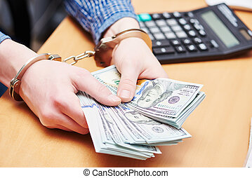 bribe concept. dollars and handcuffs - money bribe or...