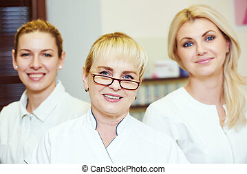 beauty salon workers - female team of beauty cosmetic salon...