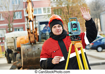 surveyor works with theodolite - surveyor worker working...