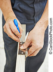door hinge installation - Close-up carpenter process of wood...