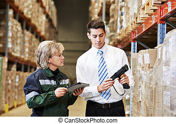 warehouse crew at work - manager and worker in warehouse...