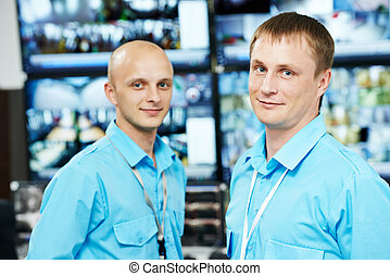 Security video surveillance team - security guar workers...