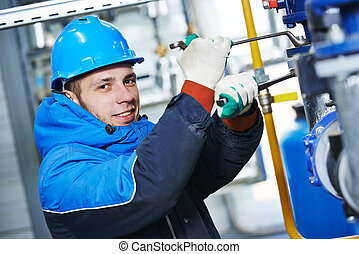 industrial worker at installation work - industrial heat...