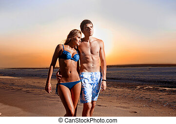 guy and his girlfriend are on the beach