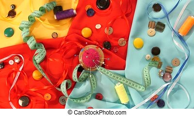 Tailor spools of colorful thread, buttons, pincushion,...