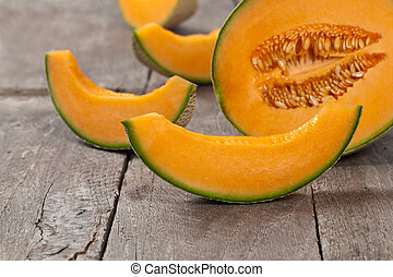 Cantaloupe Melon - Fresh melons on old wooden background...