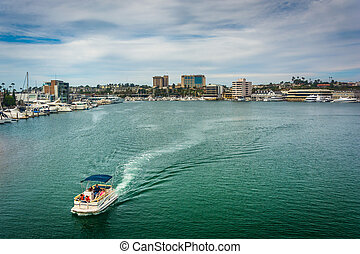 Boat in the harbor, seen from the Via Lido Bridge, in...