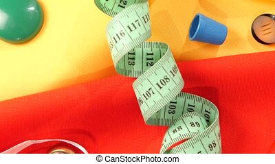 Sewing stuff like buttons, measuring tape, close up -...