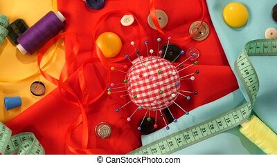 Top of colorful thread, measuring tape, buttons, pincushion...