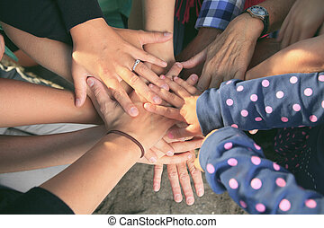 Many hands together - Lot of hands together one over the...