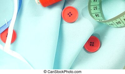 Sewing stuff like different buttons, thread, cloth, blue and...