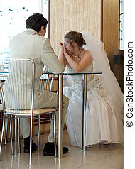 Newly married couple in the restaurant