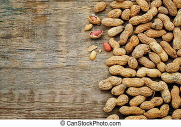 peanuts on a dark wood background. tinting. selective focus