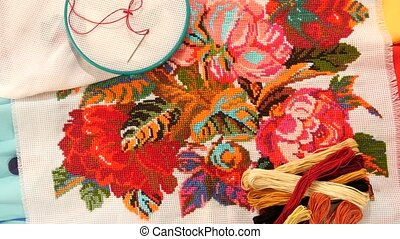 Bright embroidery with flowers, flosses thread and hoop -...