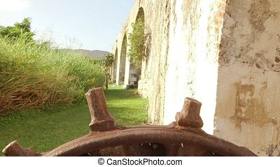 Ancient gear wheel - Aqueduct gear wheel located on a...