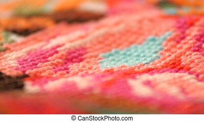 Surface of bright embroidery with flowers, close up - A...
