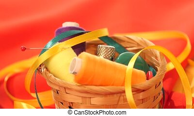 Top of basket with colorful threads, buttons, confidant,...