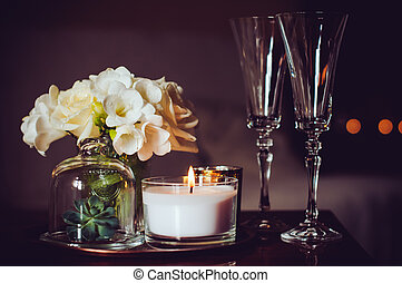 candles and champagne glasses - Bouquet of flowers in a...