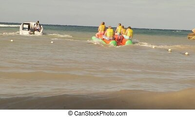 Sport boat on water having fun at the beach tubing