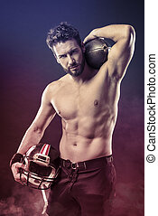 Shirtless football player with helmet - Attractive shirtless...
