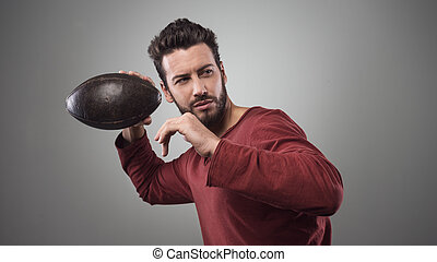 Football player launching ball - Handsome confident football...