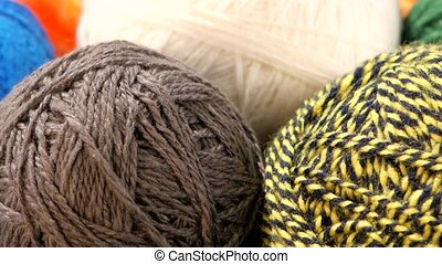 Gray, yellow-black, blue and white yarn balls, rotation,...