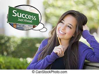 Young Woman with Thought Bubble of Success Green Road Sign