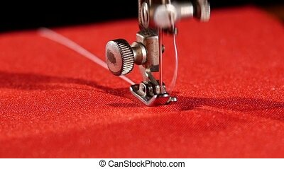 Old sewing machine on red cloth, close up, slow motion - Old...