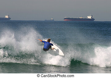 A surfer hits it off the lip while surfing at Newcastle...