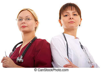doctor and nurse - female doctor and nurse in glasses with...