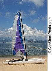 A catamaran parked on the beach on Chung Chau - Hong Kong