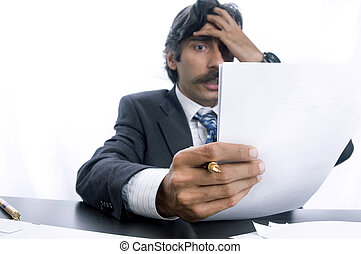 Frustrated Business Man - A frustrated man holding his head...