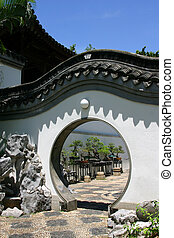 Chinese round doorway in Kowloon Walled City Park Hong Kong