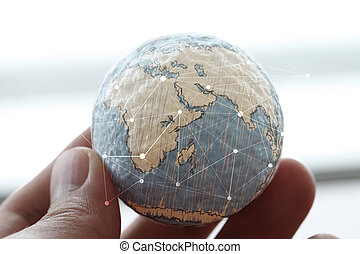 close up of businessman hand showing texture the world with dig