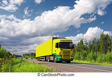truck on pictorial highway - yellow truck and cars on...