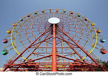 ferris wheel against a clear blue sky