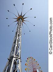 star flyer  - spinning star flyer ride in amusement park