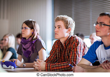 College students sitting in a classroom during class
