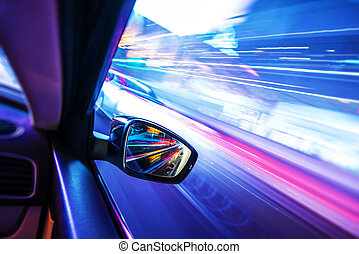 Car in Motion at Night Colorful Motion Blurs Transportation...