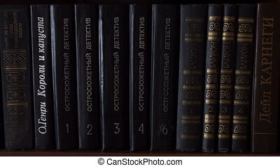 Books - book standing at bookshelf