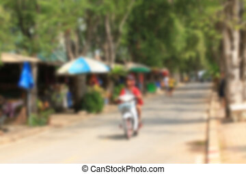 blurred of motorcycles on road