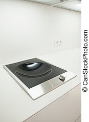 Induction hob for wok - Close-up of induction hob ideal for...