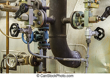 Pipes and faucet valves of heating system in a boiler room