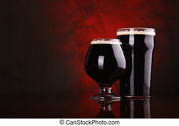 Dark stout beer - Nonic pint and snifter of dark stout beer...