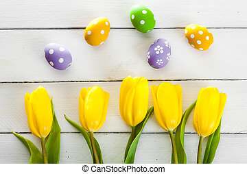 Yellow tulips on a wooden surface. Studio photography.