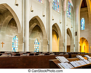 Hymnals Under Stained Glass - Hymnals in a catholic chapel...