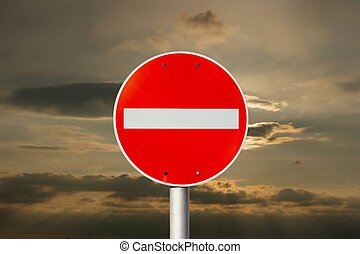 No entry traffic sign against dramatic sky